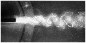 Fig. 8 : Tourbillons cavitants en aval d'un obstacle