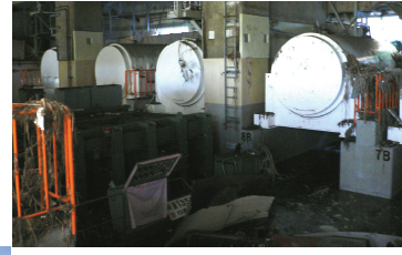 Fig. 1 : Stockage à sec en conteneur sur site à la centrale de Fukushima Daïchi, après le tsunami