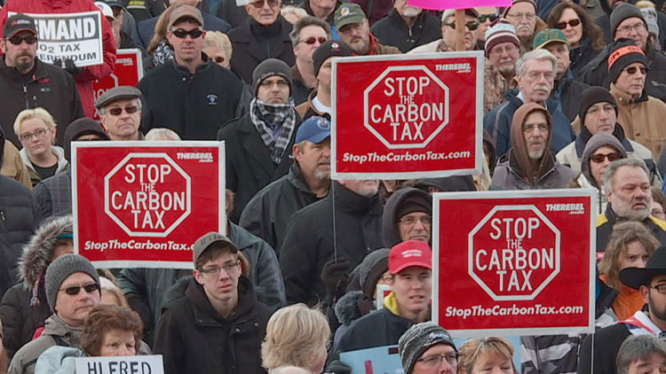 Image 6: Protesters gather to voice opposition to a carbon tax in Canada